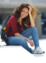 Female college student smiling outdoors portrait of a young Stock Photos