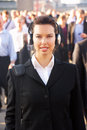 Female commuter in crowd Royalty Free Stock Photo