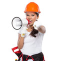 Female construction worker in action portrait of with toolbelt hold a megaphone Royalty Free Stock Photo