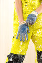 Female construction worker in coverall and protective gloves Royalty Free Stock Photography