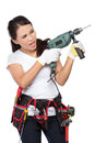 Female construction worker with drill wearing working clothes toolbelt using electric Royalty Free Stock Photo
