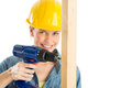 Female construction worker drilling wooden plank portrait of happy against white background Stock Images