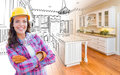 Female Construction Worker In Front of Custom Kitchen Drawing Royalty Free Stock Photo