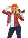 Female construction worker in a helmet with a perforator Royalty Free Stock Photo