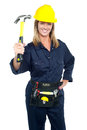 Female construction worker holding up hammer Royalty Free Stock Photo