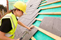 Female Construction Worker On Site Laying Slate Tiles Royalty Free Stock Photo
