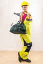 Female construction worker with tool bag indoors Stock Photos