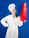 Female cook with  red plastic packages Royalty Free Stock Images