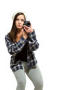 Female crouching slightly to take photo in knit cap crouches Stock Photo