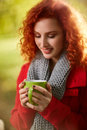 Female With Cup Of Tea In Nature