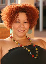 Female with Curly Red Hair and Bright Jewelry Royalty Free Stock Photography