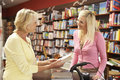 Female customer in bookshop Royalty Free Stock Photos