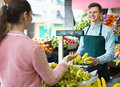 Female customer buying yellow bananas Royalty Free Stock Photo
