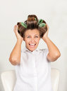 Female customer with curls in hair shouting portrait of beautiful at salon Stock Photo