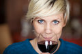 Female customer drinking red wine in restaurant closeup portrait of young Stock Image