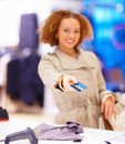 Female customer giving credit card to cashier Royalty Free Stock Photos