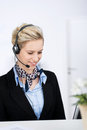 Female customer service executive with headset portrait of young while smiling in office Royalty Free Stock Image