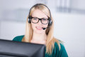 Female customer service executive speaking on headset closeup portrait of confident in office Royalty Free Stock Image