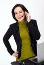 Female Customer Service Worker Smiles Talking on Headset Phone Stock Image
