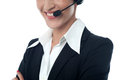 Female customer support executive cropped image of a smiling assistant over white Royalty Free Stock Images