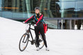 Female cyclist with courier delivery bag portrait of young in protective gear Royalty Free Stock Images