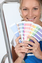 Female decorator with a selection of color swatches Stock Photography