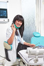 Female dentist young asian in the clinic looking to camera Stock Images
