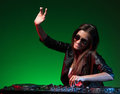 Female dj beautiful young in sunglasses spinning on turntable and gesturing Stock Photography