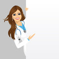 Female doctor with a blank presentation board Royalty Free Stock Photo