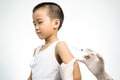 Female doctor doing injection to little boy arm Stock Images