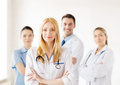 Female doctor in front of medical group attractive Royalty Free Stock Images
