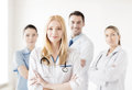 Female doctor in front of medical group attractive Royalty Free Stock Photos