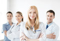 Female doctor in front of medical group attractive Stock Image
