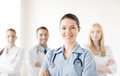 Female doctor in front of medical group attractive or nurse Royalty Free Stock Photography