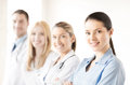 Female doctor in front of medical group attractive or nurse Stock Photos