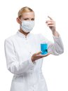 Female doctor and glass beaker Stock Images