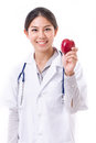 Female doctor with hand holding red apple Royalty Free Stock Photo
