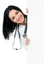 Female doctor happy young with stethoscope showing blank placard board isolated on white background Royalty Free Stock Photos