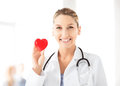 Female doctor with heart bright picture of Royalty Free Stock Photography