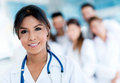 Female doctor at the hospital leading a group of medical staff Stock Image