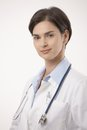 Female doctor in lab coat and stethoscope portrait Royalty Free Stock Photo
