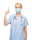 Female doctor or nurse in mask holding syringe healthcare and medical concept medical with injection Stock Photo
