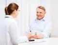 Female doctor or nurse measuring blood sugar value Royalty Free Stock Photo