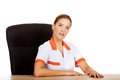 Female doctor or nurse sitting behind the desk Royalty Free Stock Photo