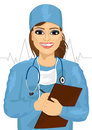 Female doctor or nurse with stethoscope taking notes Royalty Free Stock Photo
