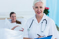 Female doctor and pregnant woman smiling at camera Royalty Free Stock Photo