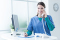 Female doctor at the reception desk Royalty Free Stock Photo