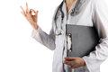 Female doctor s hand holding medical clipboard and stethoscope showing an okay sign gesture isolated on white background concept Stock Photography