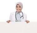 Female doctor with stethoscope holding blank white board isolated on white background Royalty Free Stock Photo