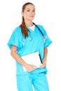 Female doctor with a tablet pc attractive serious young or nurse in green scrubs or notebook displayed in her hands Stock Photography